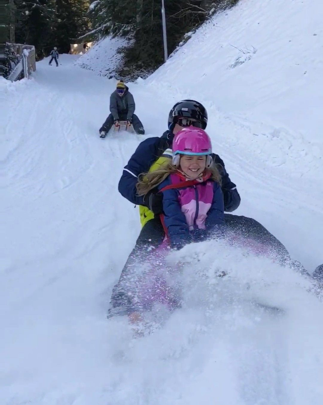 family skiing holiday - tabogganing