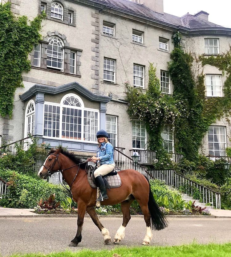horse riding past the manor house in mount juliet