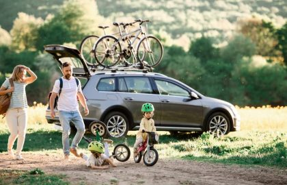 family with roof rack on their car