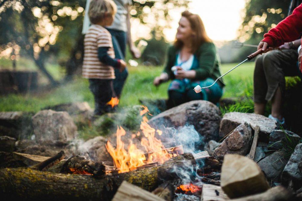 roasting marshmallows at Rock Farm Slane glamping site, close to Dublin.
