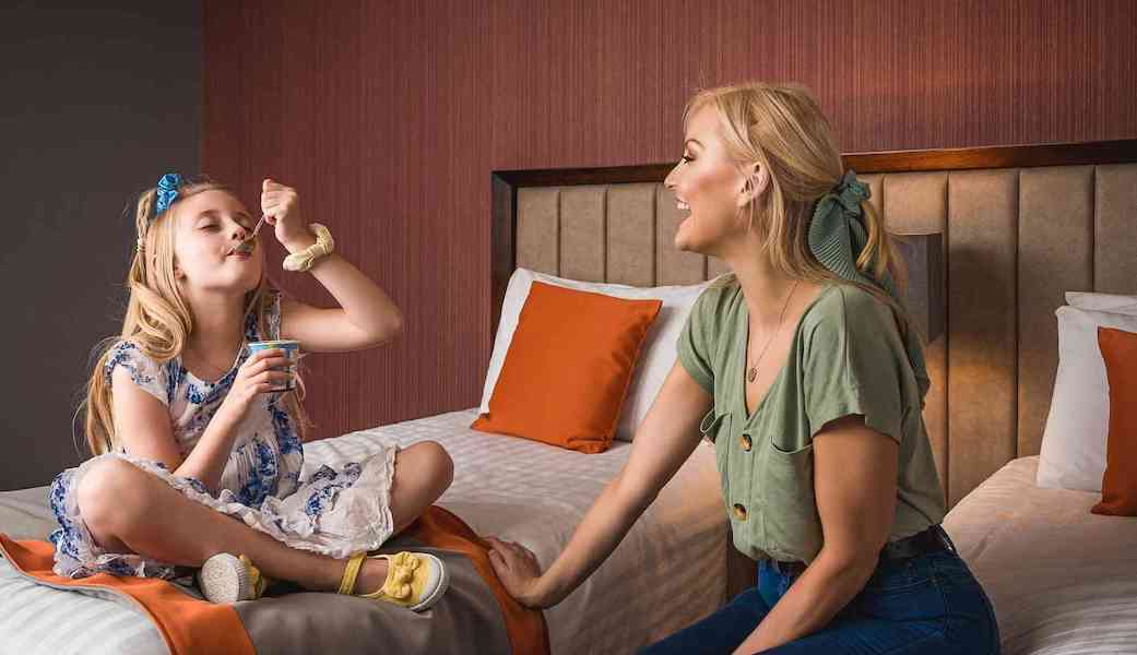 mother and daughter in hotel room.
