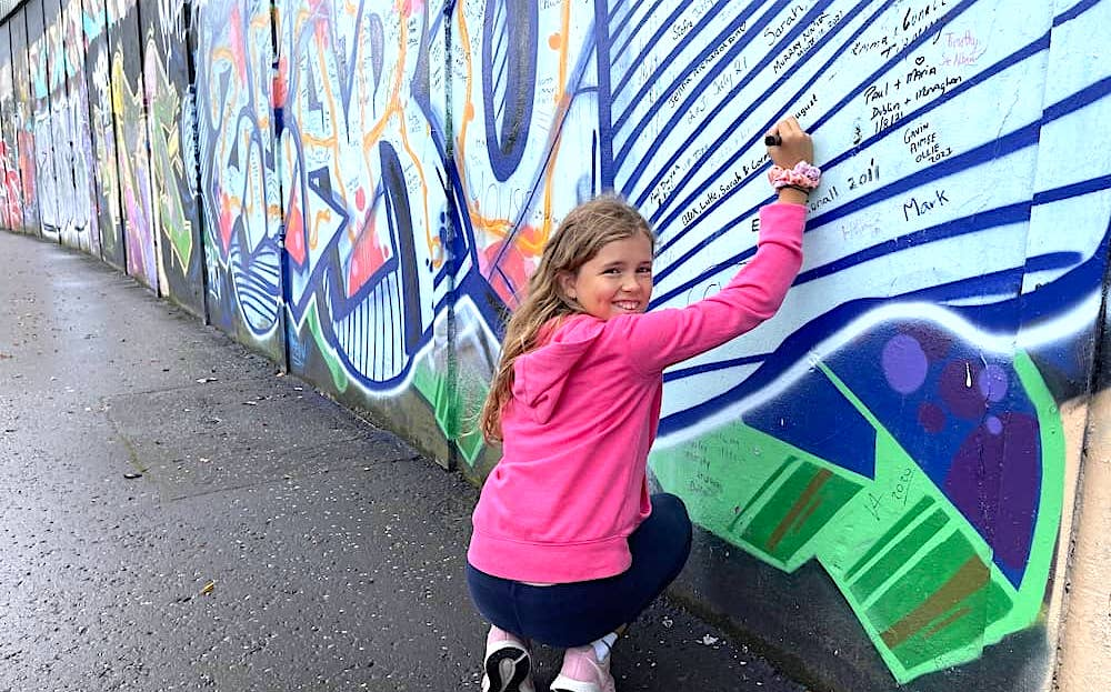 Child at the Peace Wall in Belfast